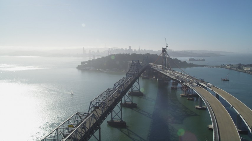 5K stock footage aerial video of passing by the Bay Bridge, new span under construction, San Francisco, California Aerial Stock Footage | JDC02_046