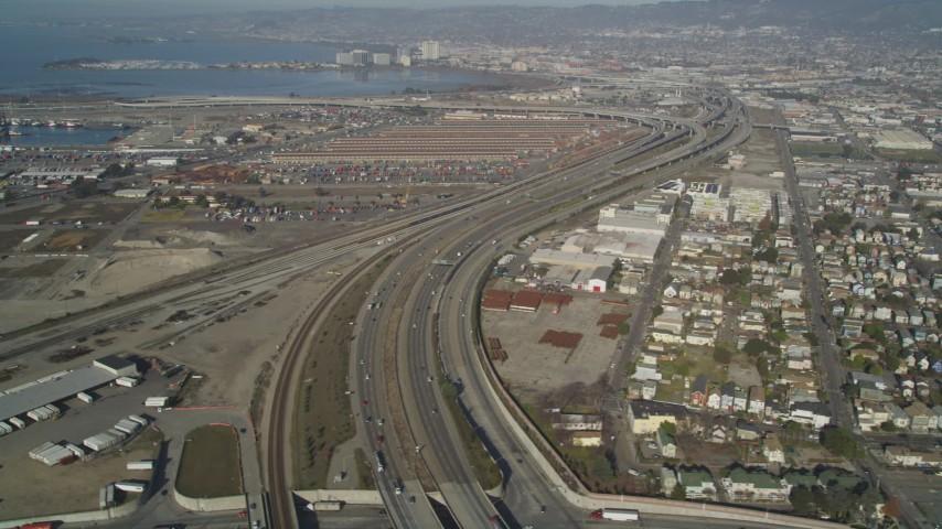 5K stock footage aerial video of flying by I-880 freeway, revealing urban neighborhoods, Oakland, California Aerial Stock Footage | JDC02_047