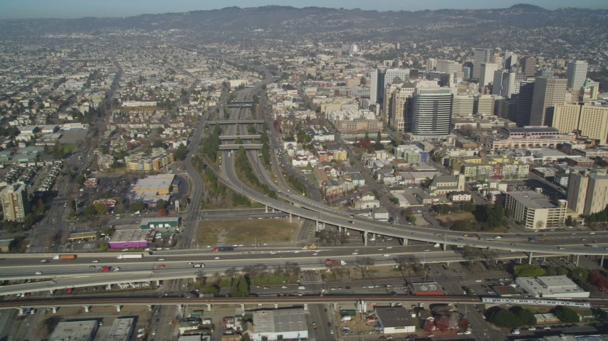5K stock footage aerial video of flying by 880 freeway and urban neighborhoods, revealing I- 980, Downtown Oakland, California Aerial Stock Footage | JDC02_048