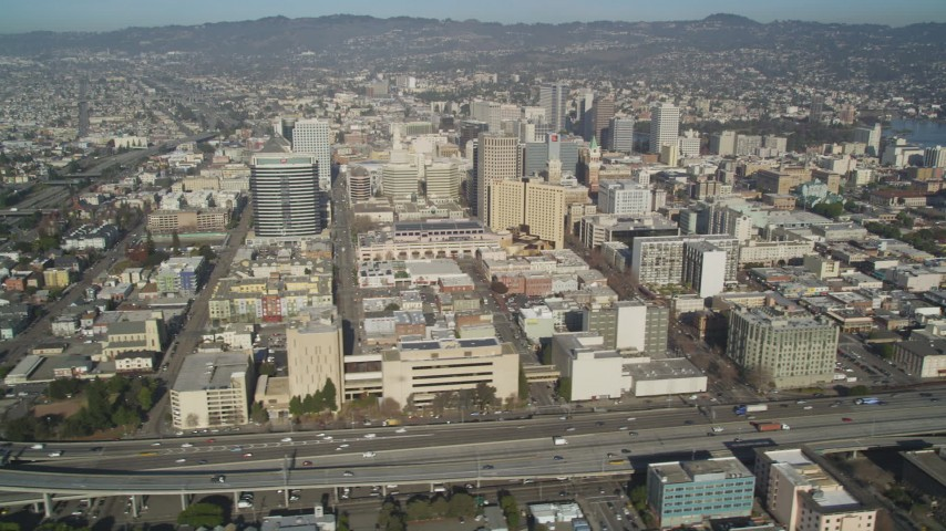 5K stock footage aerial video of flying by city office buildings and freeways, Downtown Oakland, California Aerial Stock Footage | JDC02_049