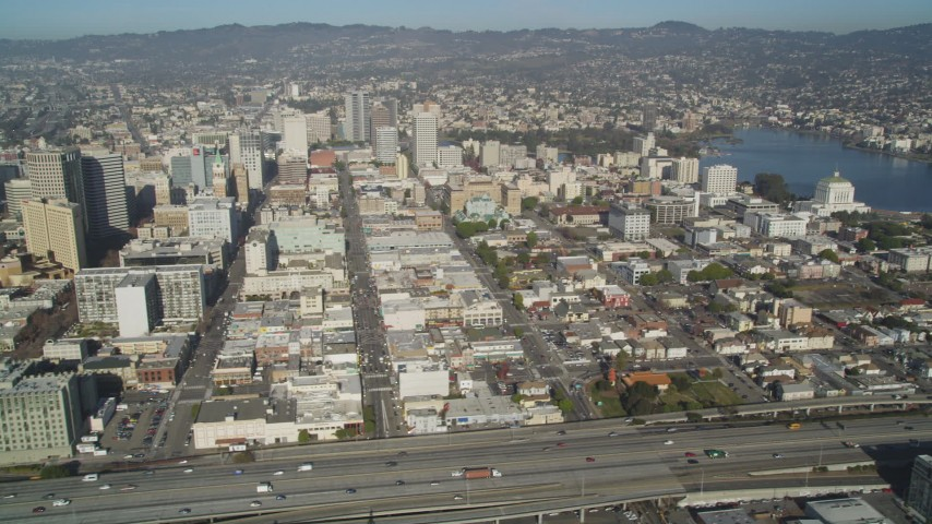5K stock footage aerial video of flying by the city's office buildings and Lake Merritt, Downtown Oakland, California Aerial Stock Footage | JDC02_050
