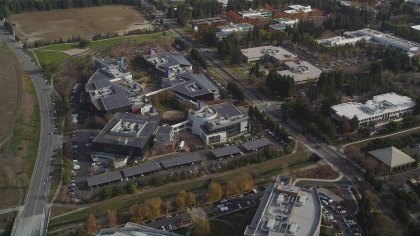 5K stock footage aerial video of tilting to reveal office complexes, Googleplex buildings, Mountain View, California Aerial Stock Footage | JDC03_018