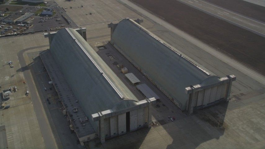 5K stock footage aerial video of flying by Hangar Two and Three, Moffett Field military base, Mountain View, California Aerial Stock Footage | JDC03_022