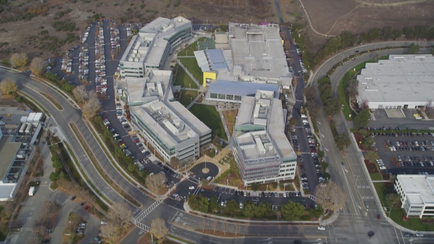 5K stock footage aerial video tilt from parking lots, revealing Yahoo! Campus office buildings, Sunnyvale, California Aerial Stock Footage | JDC03_026