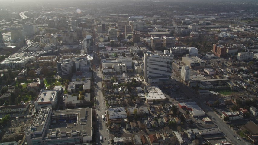5K stock footage aerial video of following East San Fernando Street, approaching city hall, Downtown San Jose, California Aerial Stock Footage | JDC04_004