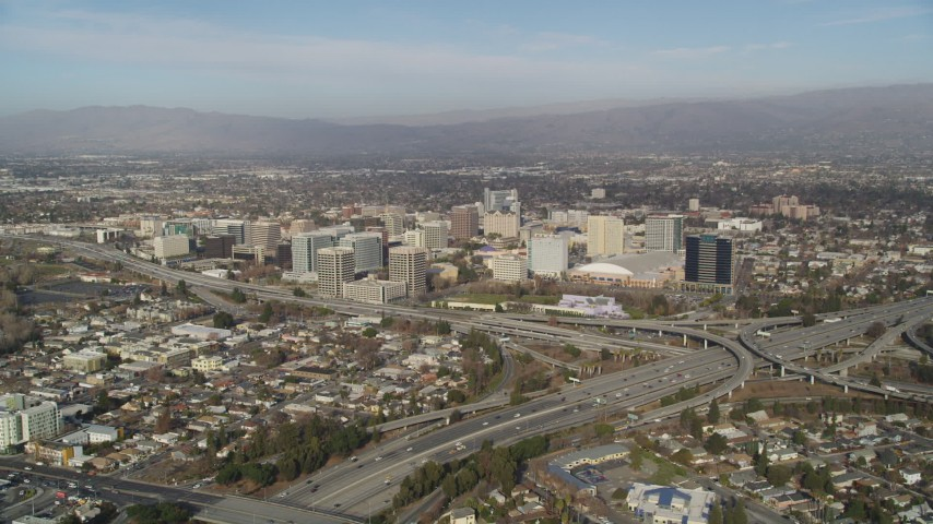 5K stock footage aerial video of flying by freeway interchange with a view of Downtown San Jose, California Aerial Stock Footage | JDC04_006