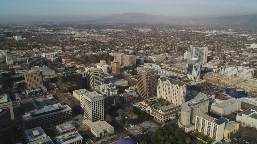 5K stock footage aerial video of flying over the city, approaching San Jose City Hall, Downtown San Jose, California Aerial Stock Footage | JDC04_008