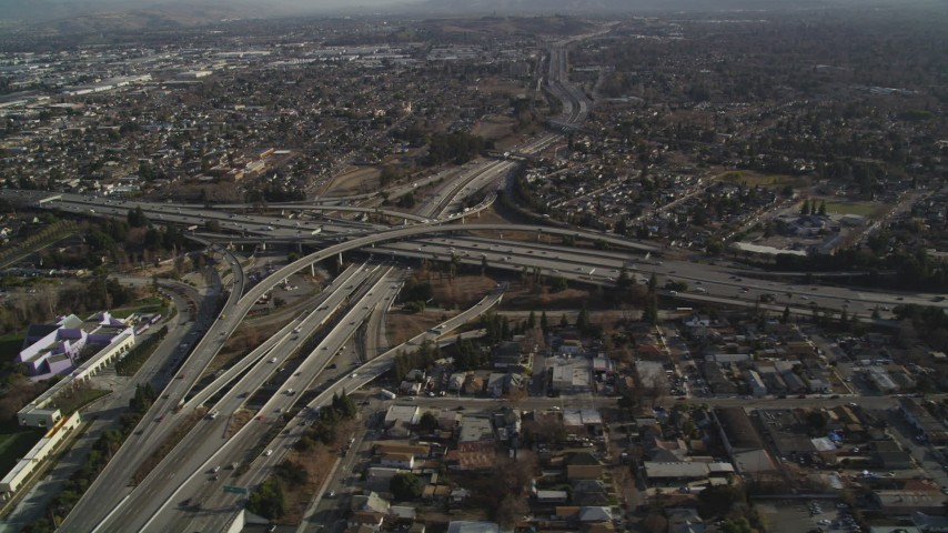 5K stock footage aerial video approach freeway, reveal busy interchange near Downtown San Jose, California Aerial Stock Footage | JDC04_010