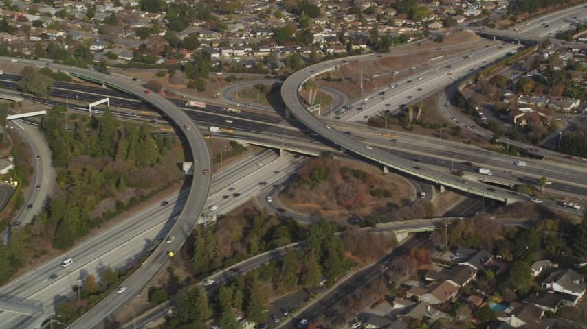 5K stock footage aerial video of flying by Highway 87/Interstate 280 freeway interchange, Downtown San Jose, California Aerial Stock Footage | JDC04_011