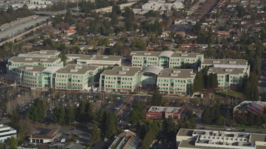 5K stock footage aerial video of flying by Apple Headquarters office buildings, Cupertino, California Aerial Stock Footage | JDC04_015