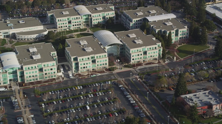 5K stock footage aerial video of flying away from Infinite Loop 1 office building at Apple Headquarters, Cupertino, California Aerial Stock Footage | JDC04_018