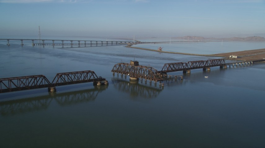 5K stock footage aerial video of flying by a railroad bridge, Dumbarton Bridge, San Francisco Bay, California Aerial Stock Footage | JDC04_034