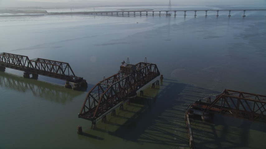5K stock footage aerial video of passing by a railroad bridge near Dumbarton Bridge, San Francisco Bay, California Aerial Stock Footage | JDC04_035
