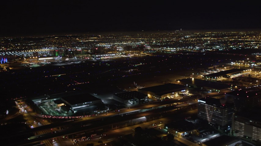 5K stock footage aerial video track a passenger jet landing at night, LAX (Los Angeles International Airport), California Aerial Stock Footage | LD01_0006