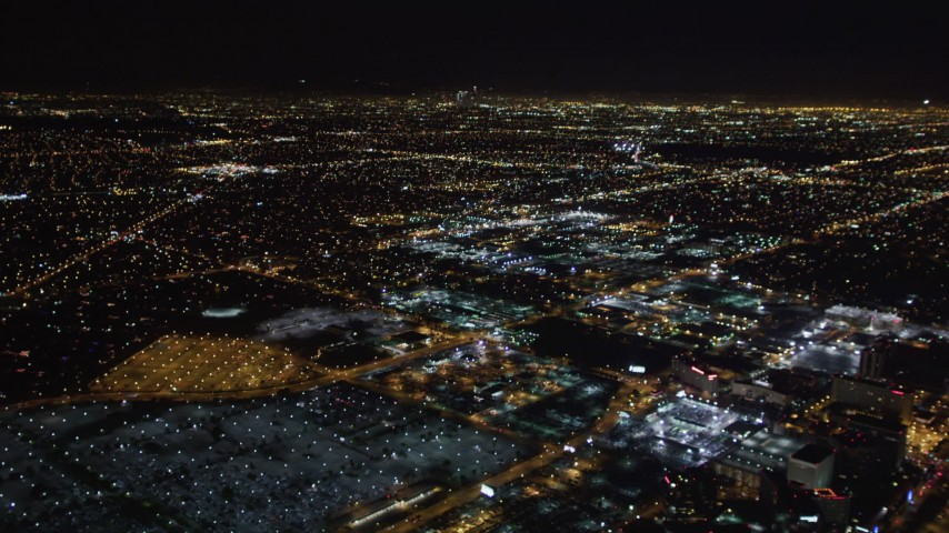 5K stock footage aerial video track a passenger jet landing at night, LAX (Los Angeles International Airport), California Aerial Stock Footage | LD01_0016