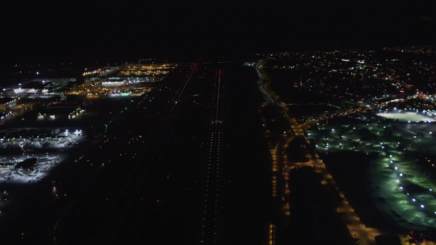5K stock footage aerial video of a jet on the runway at LAX (Los Angeles International Airport), California at night Aerial Stock Footage | LD01_0017