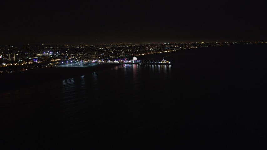 5K stock footage aerial video an approach to Santa Monica Pier, California at night Aerial Stock Footage | LD01_0038