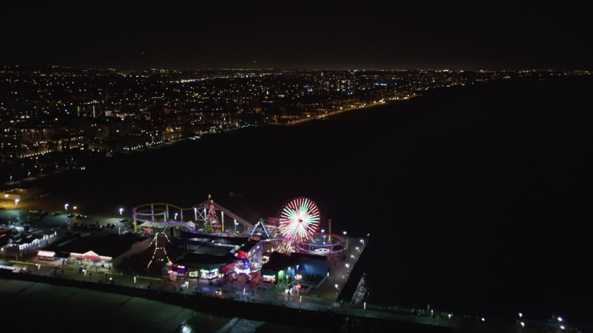 5K stock footage aerial video approach and fly over Santa Monica Pier, California at night Aerial Stock Footage | LD01_0040