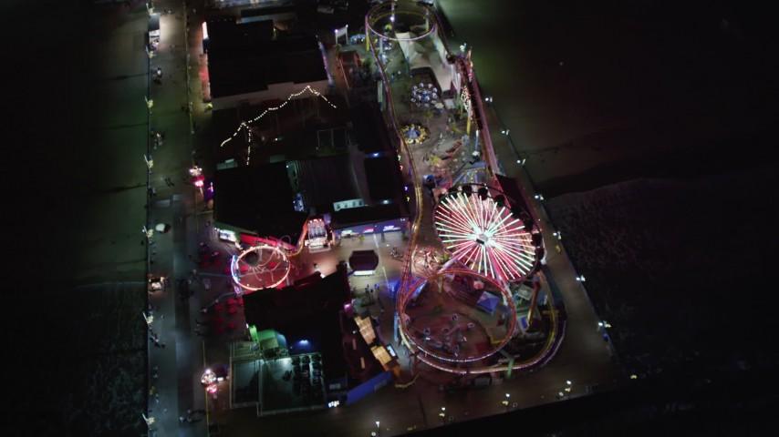 5K stock footage aerial video tilt to a bird's eye of the Ferris wheel at Santa Monica Pier, California at night Aerial Stock Footage | LD01_0042