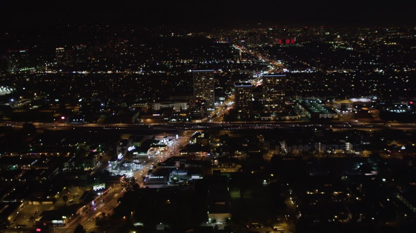 5K stock footage aerial video approach office buildings near 405 at night West Los Angeles, California Aerial Stock Footage | LD01_0043