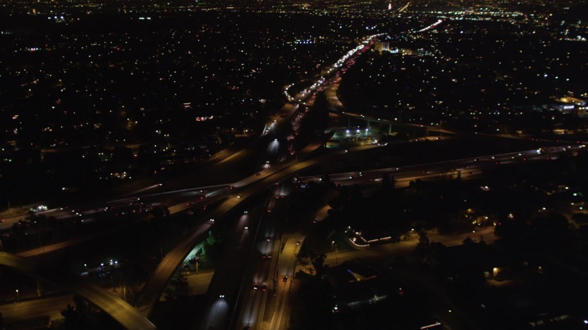 5K aerial stock footage video light traffic on freeway interchange at night, West Los Angeles, California Aerial Stock Footage | LD01_0045