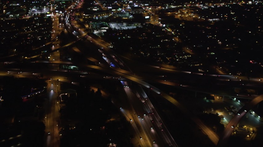 5K stock footage aerial video orbit a freeway interchange at night in West Los Angeles, California Aerial Stock Footage | LD01_0046