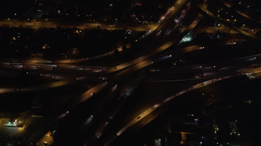 5K stock footage aerial video orbit of a freeway interchange at night in West Los Angeles, California Aerial Stock Footage | LD01_0047