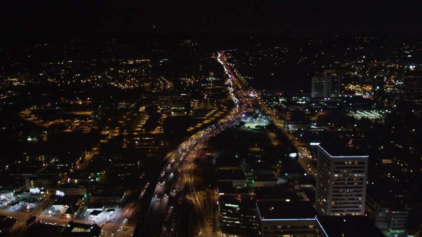 5K stock footage aerial video of the 405 freeway at night in West Los Angeles, California Aerial Stock Footage | LD01_0048