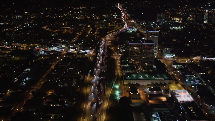 5K stock footage aerial video following the 405 at night through West Los Angeles, California Aerial Stock Footage | LD01_0049