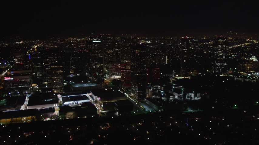 5K stock footage aerial video approach skyscrapers at night in Century City, California Aerial Stock Footage | LD01_0054