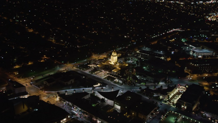 5K stock footage aerial video approach the Beverly Hills Police Department building at night, California Aerial Stock Footage | LD01_0058