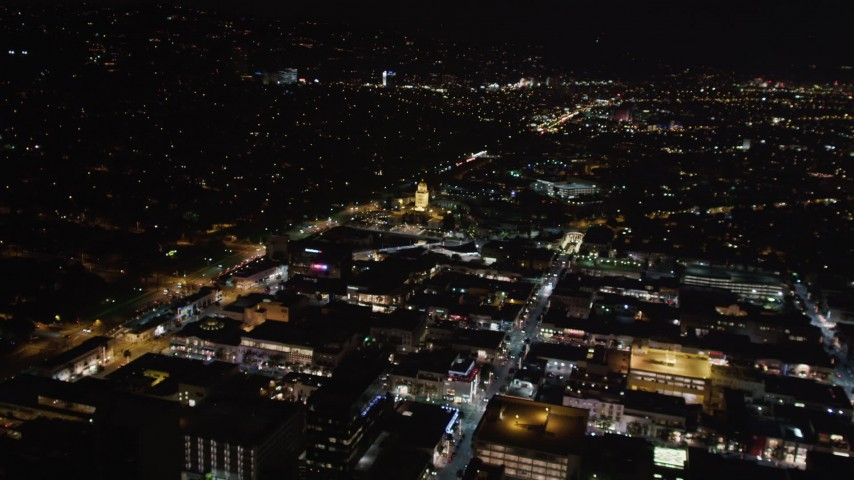 5K stock footage aerial video flying toward the Beverly Hills Police Department at night, California Aerial Stock Footage | LD01_0060