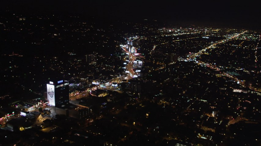 5K stock footage aerial video of approaching Sunset Strip at night in West Hollywood, California Aerial Stock Footage | LD01_0061