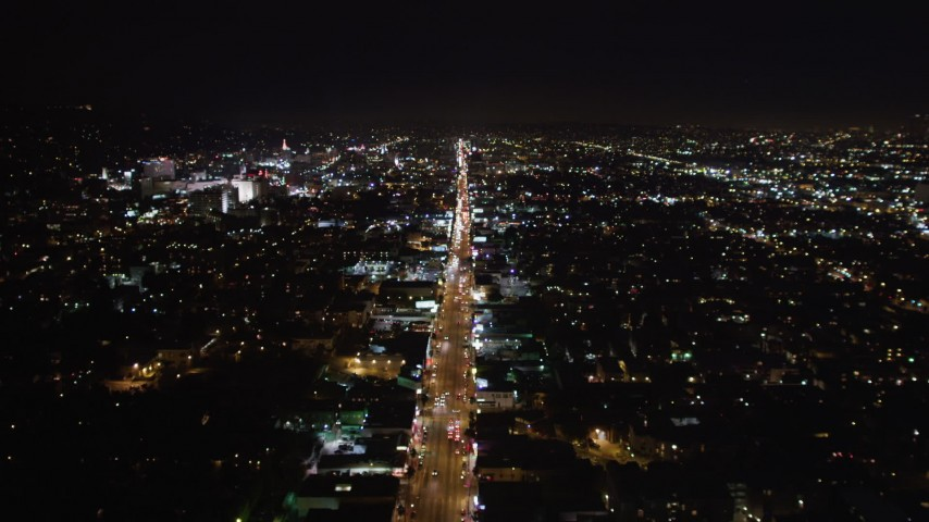 5K stock footage aerial video tilt from bird's eye of Sunset Strip in West Hollywood, California at night Aerial Stock Footage | LD01_0068