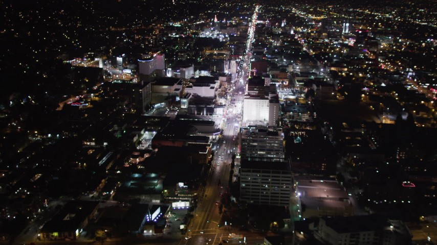 5K stock footage aerial video approach Hollywood Boulevard at night in Hollywood, California Aerial Stock Footage | LD01_0069