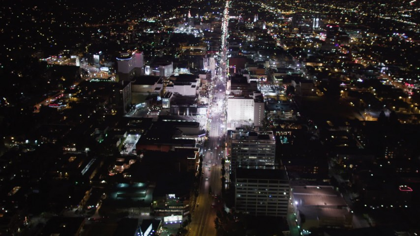 5K stock footage aerial video approach hotels and theaters at night in Hollywood, California Aerial Stock Footage | LD01_0070