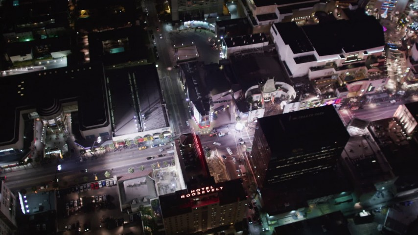 5K stock footage aerial video of Grauman's Chinese and Kodak Theaters at night in Hollywood, California Aerial Stock Footage | LD01_0073