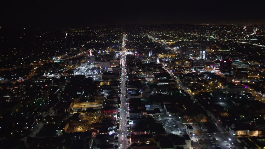 5K stock footage aerial video tilt from hotels and theaters up Hollywood Boulevard at night, Hollywood, California Aerial Stock Footage | LD01_0074