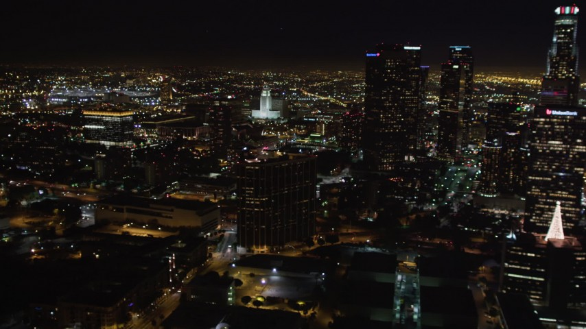 5K stock footage aerial video of city hall, and reveal skyscrapers at night in Downtown Los Angeles, California Aerial Stock Footage | LD01_0075