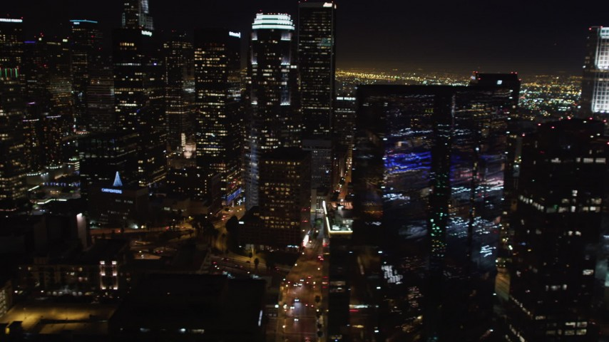 5K stock footage aerial video pan across Downtown Los Angeles, California skyscrapers at night Aerial Stock Footage | LD01_0076