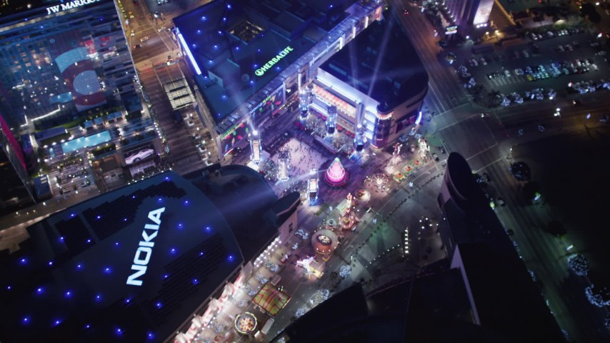 5K stock footage aerial video orbit ice skating at Nokia Theater, and tilt to hotels at night Downtown Los Angeles, California Aerial Stock Footage | LD01_0082