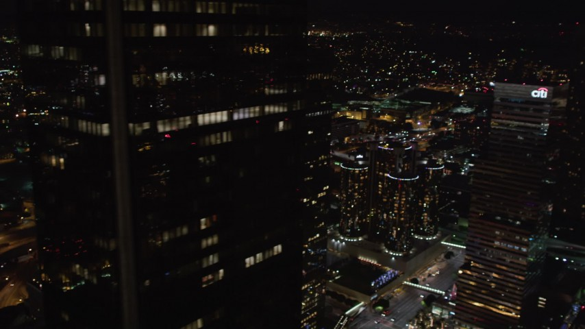 5K stock footage aerial video flyby skyscrapers to reveal city hall at night Downtown Los Angeles, California Aerial Stock Footage | LD01_0085