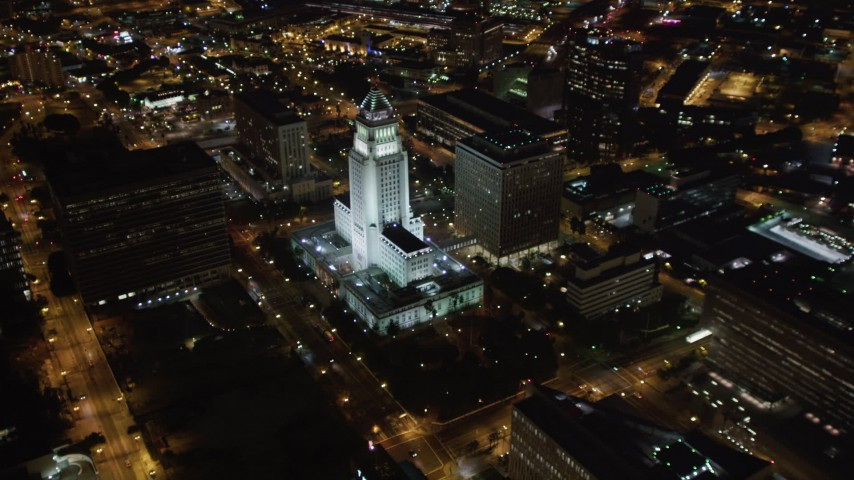 5K stock footage aerial video flyby skyscrapers at night in Downtown Los Angeles, California toward city hall Aerial Stock Footage | LD01_0086