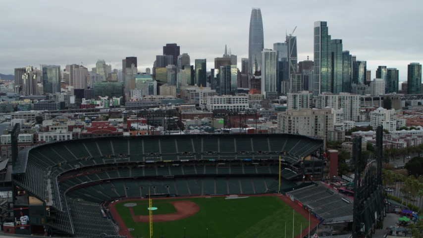5.7K stock footage aerial video of ascending near AT&T Park baseball stadium and pan to city skyline, Downtown San Francisco, California Aerial Stock Footage | PP0002_000001