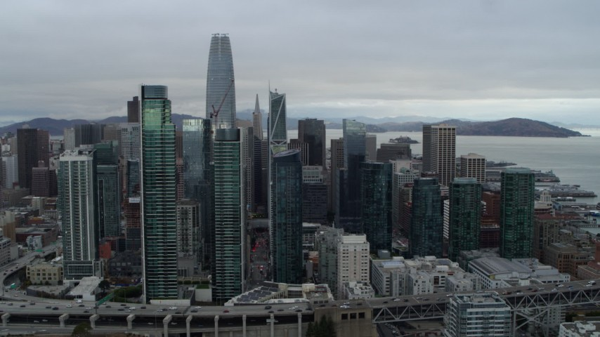 5.7K stock footage aerial video ascend by skyscrapers in city's skyline, Downtown San Francisco, California Aerial Stock Footage | PP0002_000009