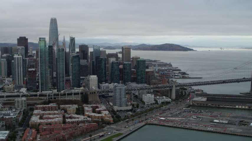 5.7K stock footage aerial video pan from skyscrapers in city's skyline to Bay Bridge, Downtown San Francisco, California Aerial Stock Footage | PP0002_000011