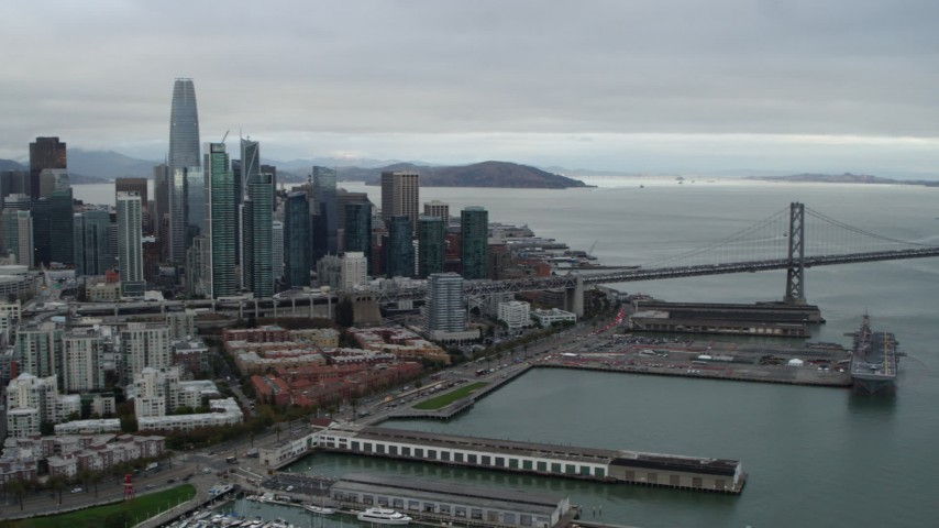 5.7K stock footage aerial video pan from Bay Bridge to reveal city's skyline, Downtown San Francisco, California Aerial Stock Footage | PP0002_000012