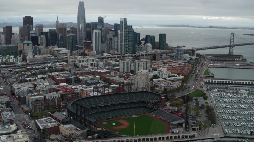 5.7K stock footage aerial video of AT&T Park, with city skyline in background, Downtown San Francisco, California Aerial Stock Footage | PP0002_000014