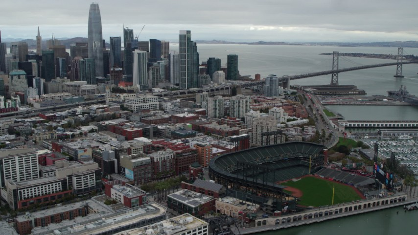 5.7K stock footage aerial video flying by AT&T Park, with city skyline in background, Downtown San Francisco, California Aerial Stock Footage | PP0002_000015