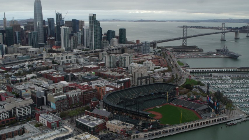5.7K stock footage aerial video flying by AT&T Park, tilt to city skyline in background, Downtown San Francisco, California Aerial Stock Footage | PP0002_000016